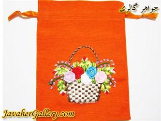کیف کتانی دست دوز نارنجی با سبد و گلهای ابریشمی رنگارنگ