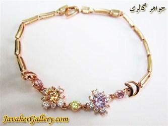 دستبند ژوپینگ xuping زیبا با روکش آب طلا و نگینهای آبی طلایی رنگارنگ